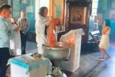 Священник игумен Фотий (Нечепоренко) насильно крестит малыша