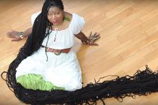 Аша Мандела, – обладательница самых длинных дредов в мире.
